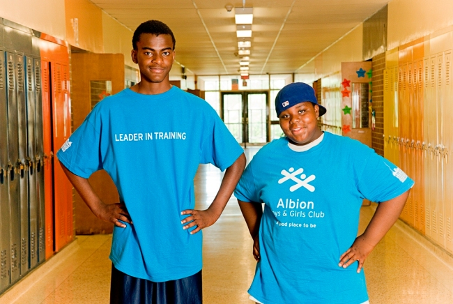 Kwaku and Imisi at a summer camp wearing their leadership t-shirts